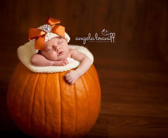 Organic Cotton Beanie Hat - Ivory with Orange Satin Bow and Rhinestone - Fancy Newborn Photo Prop. $32.00, via Etsy.
