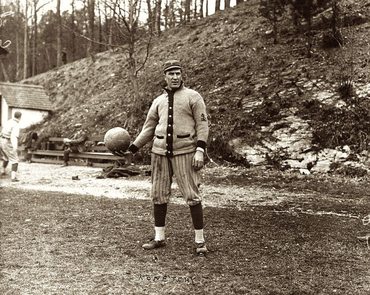 SPRING TRAINING: Ed Konetchy, with the Pittsburgh Pirates, standing, while holding a medicine ball  1914 April 8.  Spring training in Arkansas.