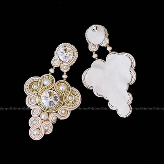 Elegant massive wedding earrings are handmade sew from: * soutache braids * swarovski crystals * glass crystals * glass pearls * toho beads * silver earrings studs On the back they have white leather. Earrings: Total length: 8,5 cm Total width: 5 cm Color combinations: white&gold or
