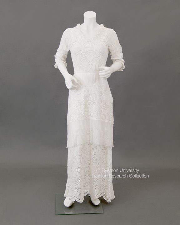 White cotton cutwork and eyelet summer dress, 3/4 sleeves with lace fringe, long tiered skirt with scalloped hem, machine lace trim, c.1912-1914. No label. FRC2014.01.034