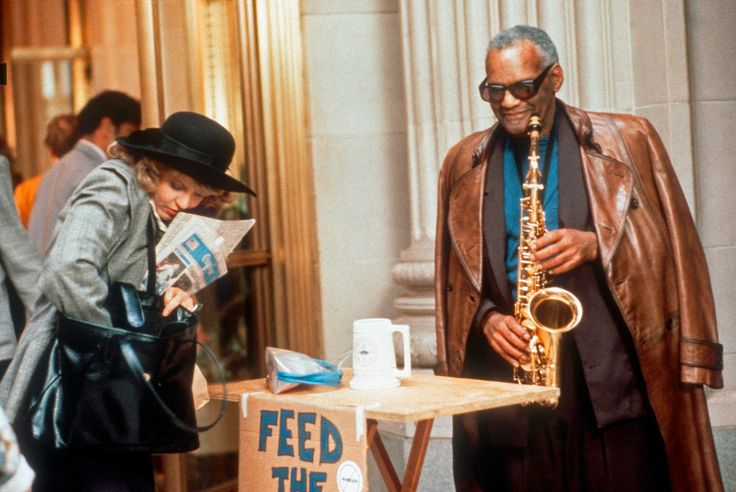 "Set photo from the movie Limut Up (1989): Nancy Allen and Ray Charles, playing the archangel Julius. As the director explained it: ""a sax player who stands in front of the CBOT, and depending if you tip him or not, that's how well you're going to do that day. Its subplot is ending world hunger through manipulating soybean prices."""