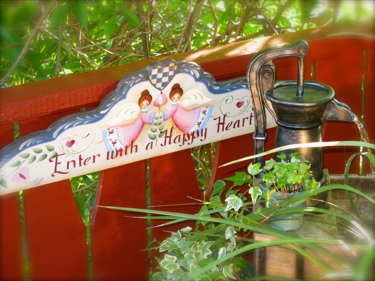 A handpainted garden sign welcome visitors to my garden.
