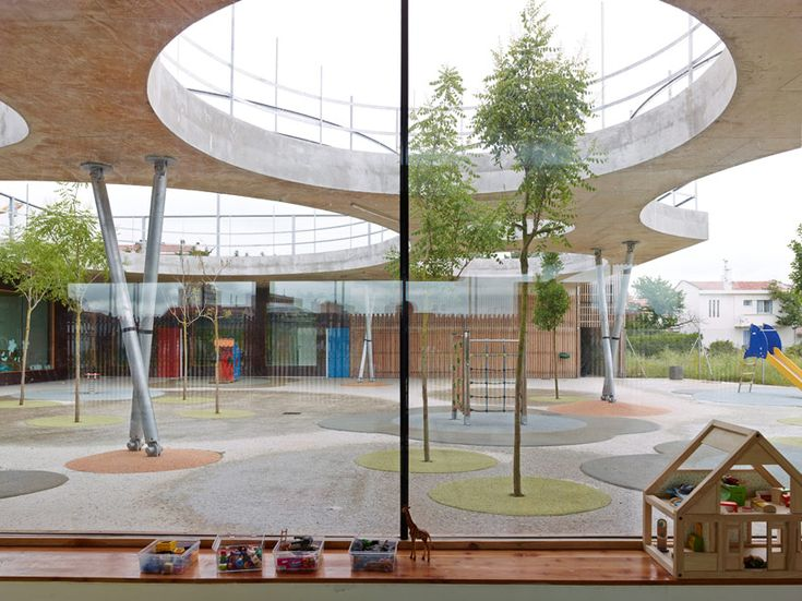 the courtyard's roof is punctured with round holes, providing enough room for trees to grow through