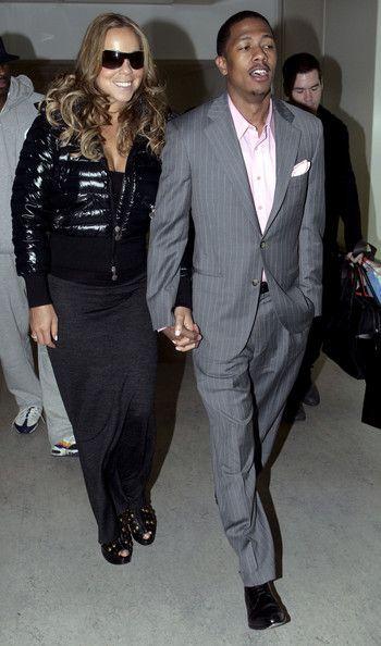 Mariah Carey Photos - Mariah Carey and Nick Cannon land at London's Heathrow Airport with a load of luggage. - Mariah Carey and Nick Cannon at Heathrow