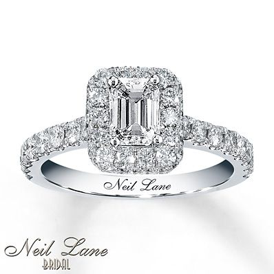 A captivating emerald-cut diamond is the star of this engagement ring from the Neil Lane Bridal collection. Round diamonds frame the center and line the band of 14K white gold, which features Neil Lane's signature on the inside. The diamond engagement ring has a total diamond weight of 1 3/8 carats.