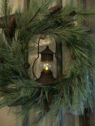 Yes!  Wreaths around the mantel lanterns!