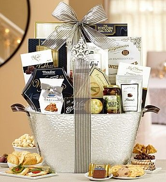 Regal Opulence Gourmet Gift Basket from 1-800-Baskets.com.  The handsome, hammered silver basket will catch your eye, but the Ghirardelli® chocolates and The Popcorn Factory® Kettle Popcorn plus other sweet and savory snacks.  Get your rebate from RebateGiant.