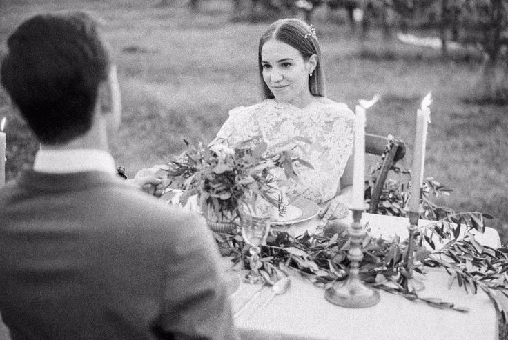 Lovely bride at the wedding table black and white