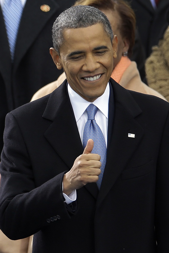 President Barack Obama flashes a thumbs up at the ceremonial swearing-in at the U.S. Capitol during the 57th Presidential Inauguration in Washington, Monday, Jan. 21, 2013.