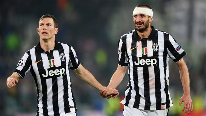 Stephan Lichtsteiner and Giorgio Chiellini (R) of Juventus celebrate their victory at the end of their UEFA Champions League semi-final first leg against Real Madrid CF