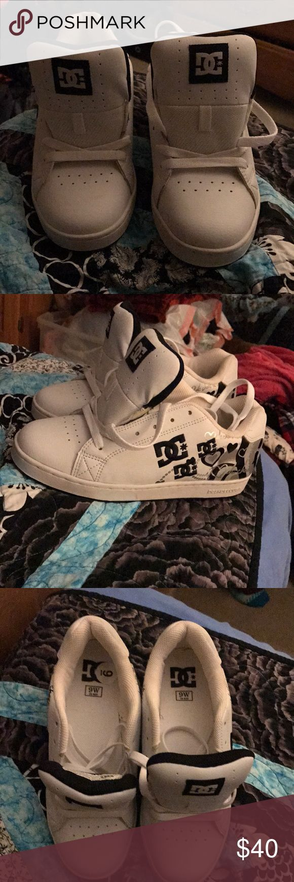 Women's size 9 BRAND NEW DC shoes All white shoes with some black and gray DC graphics on the side and back DC Shoe Company Shoes Sneakers
