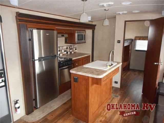 2016 New Forest River Rv Vibe Extreme Lite 312BHS Travel Trailer in Oklahoma OK.Recreational Vehicle, rv, 2016 Forest River RV Vibe Extreme Lite 312BHS, The Vibe Extreme Lite 312BHS travel trailer by Forest River features a rear  bunk house and triple slides.As you enter the travel trailer to the right there is a large pantry. Just around the corner from the pantry you will find an entertainment center. To the left of the entrance you will find a slide with a three burner range, microwave…
