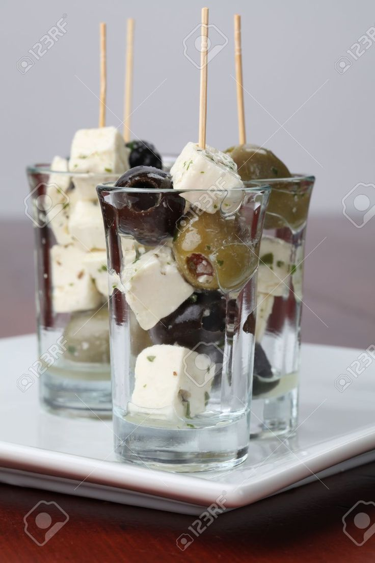 Greek appetizers with black and green olives and feta cheese