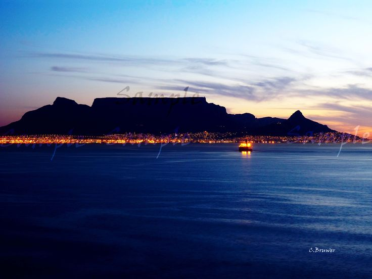Click on image to view non sample image. Early evening photograph of Table Mountain in Cape Town South Africa taken at eye level.  Really nice calming piece.