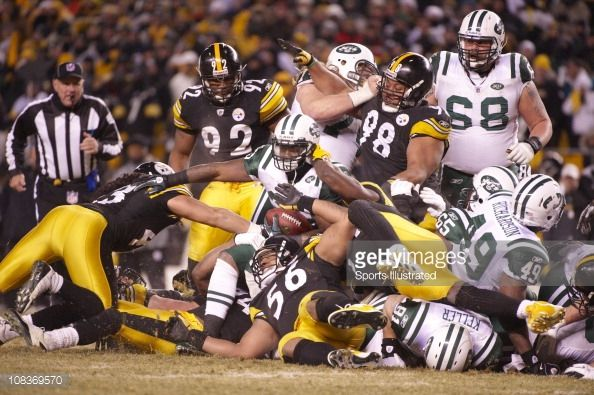 Pittsburgh Steelers Troy Polamalu , LaMarr Woodley , James Harrison , Casey Hampton and Lawrence Timmons in action, defense vs New York Jets Shonn Greene at Heinz Field.Pittsburgh, PA...