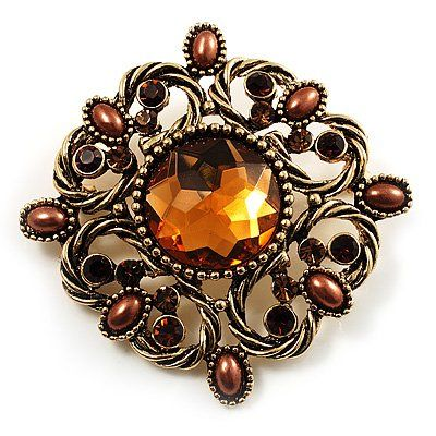 $17.11 Add a chic finishing touch to your outfit with this pretty Vintage Filigree Crystal Brooch. It features an antique gold filigree design, decorated with a round-cut faceted centre stone and small faux pearl beads in hues of amber, citrine and coffee, offering a vintage style. The brooch measures about 53mm x 53mm and fastens with a flag pin and revolver clasp.: Gold Colour, Filigree Crystals, Crystals Brooches, Vintage Filigree, Vintage Brooches, Filigr Crystals, Antique Gold, Brooches Antiques, Antiques Gold