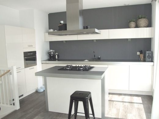 White cabinets with gray and white walls... Now with black floors...