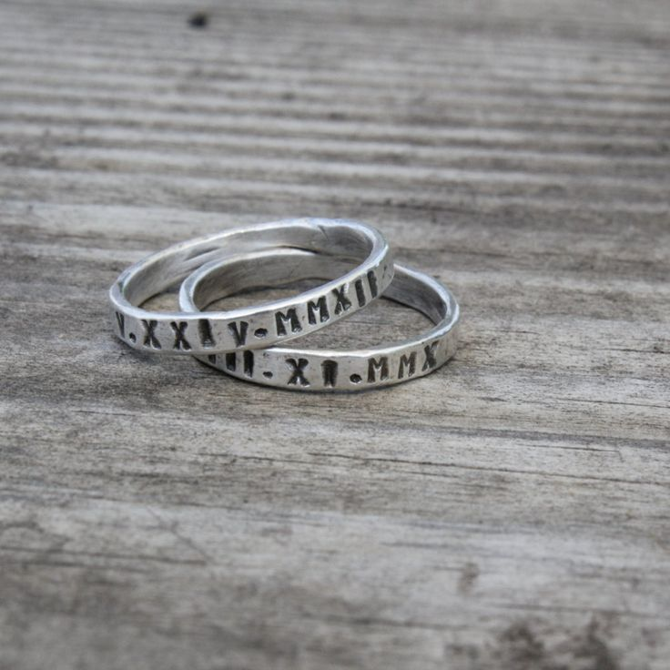 These rings are so perfectly imperfect....I just love them! These rings start out as heavy gauge fine silver wire which I hammer and fuse together to create these little beauties. Fine silver is 99.9% pure silver and rarely tarnishes.  Each ring is roughly 2mm wide and stamped with roman numerals, but names and dates are also an option. Rings are hammered which give them a rustic and organic feel. Please leave your information for personalizing the rings in the note to seller box during…