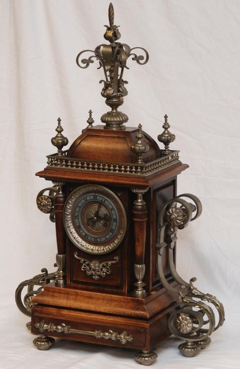 Antique French wooden mantle clock with silvered bronze mountings and feet, late 19th century.