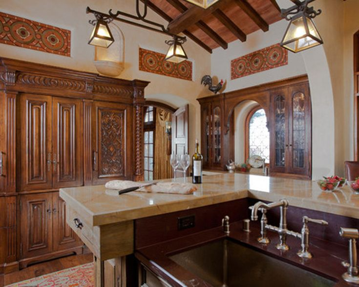 Detailed wood and tile work paired with a custom iron chandelier.