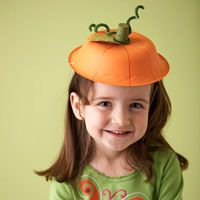 Painted Halloween Pumpkin Hat -this is perfect for our walking field trip to the retirement home... They always want us early on Halloween, and we can't put on our costumes at school until after lunch.