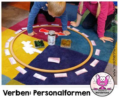 http://www.bloglovin.com/blogs/teacher-in-wonderland-12556523/verben-personalformen-bilden-eine-lernspiel-4564804102: Spielidee mit Spinner Pfeil dreht sich in der Mitte, Kind muss jeweilige Aufgabe erfüllen, wenn richtig, bekommt Muggelstein, Spiel, Idee, Vorschlag, Gesellschaftsspiel, Brettspiel