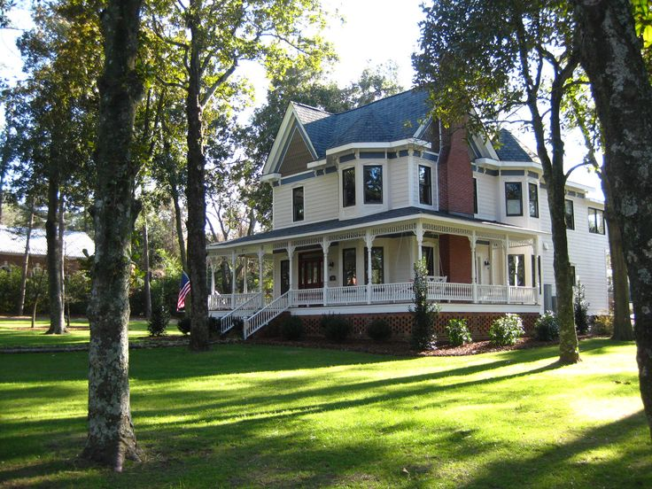 I love the huge grassy yard, old fashioned house, and wrap-around porch with a porch swing so much
