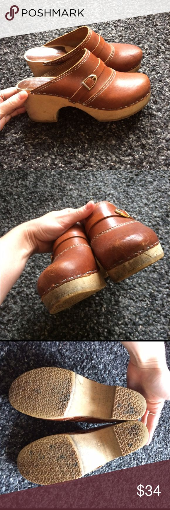 vintage cognac leather heeled clogs Very, very cool authentic vintage wooden clogs. Cognac leather, small gold buckles. Brand name has worn off, but were made in Sweden. Decent amount of wear--some scuffing to the leather toes, and some scrapes and discoloration to the wood sole. Very little wear to the rubber soles. Overall very sturdy, and will last for years more. Sized 38 but fits a modern 6.5/7. Not FP--just using for exposure! Free People Shoes Mules & Clogs