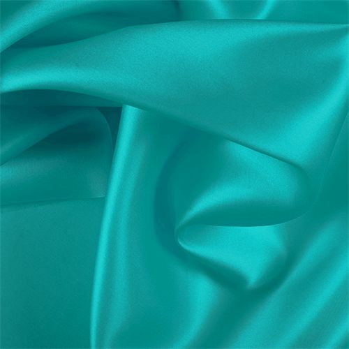 Solid Teal Green Silk Satin Organza FabricA beautiful organza with a satin finish. Superior body and suppleness. The perfect fabric for creating a sheer coat over a bridal dress or a classic blouse or long coat to dress up an evening outfit.16MMCompare to $37.48 a yardFabric is reorderable as neededPlease allow 3-5 business days before it ships1 YARD MINIMUM CUTNO SAMPLES ARE AVAILABLE