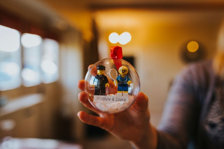 Present from the groom - a Christmas bauble with lego versions of the pilot groom and PE teacher bride! Amazing. Photo by Benjamin Stuart Photography #weddingphotography #christmaswedding #groomgift #bridegift #bauble #gift #weddingday #lego
