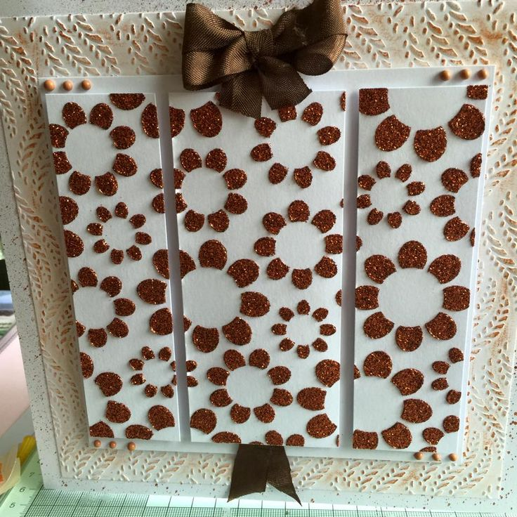using Phill Martin texture paint in pumpkin, and guiding wax on embossing folder