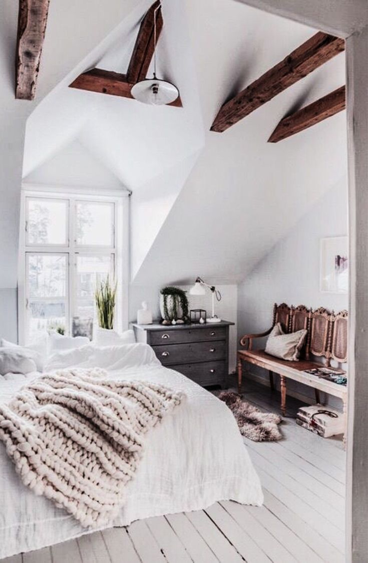 Add rustic beams to rooms with vaulted ceilings to add a rustic feel