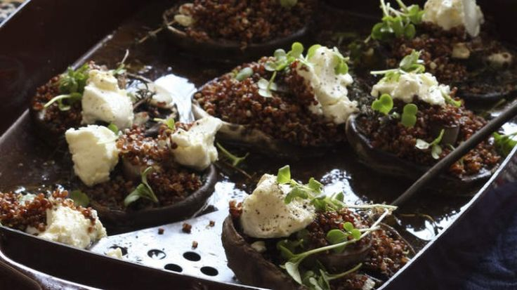 Baked portobello mushrooms topped with quinoa, feta and micro herbs