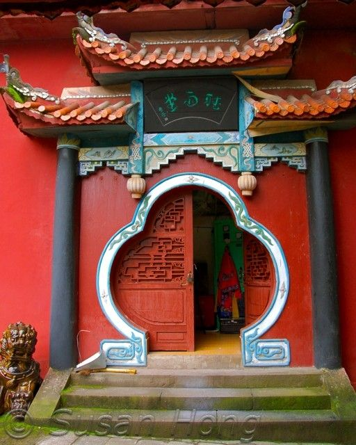 Red Chinese door. Red in Chinese culture means good luck, happiness and joy. Love the bold play with color that is shown in Chinese architecture.