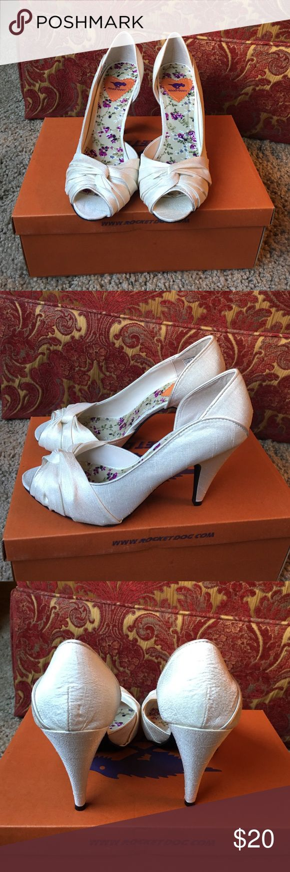 Rocket Dog pearl cream satin like heels Worn just a few hours. These pictures don't do the heels justice. Their a beautiful pearl cream satin like material. In PERFECT CONDITION! Rocket Dog Shoes Heels
