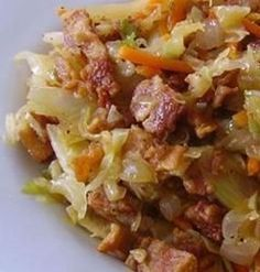Fried Cabbage with Bacon Onion and Garlic - This is a family favorite that is put into every cookbook for my kids when they move out and get married. It is a beautiful dish with many colors and full of flavor. Warning, it is addictive.
