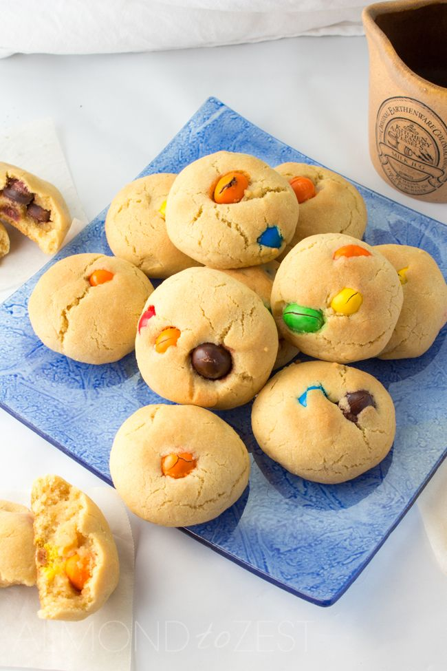 Peanut MnM Cookies - Big, soft and chewy these cookies are bursting with lots and lots of peanut MnM's! Super quick and easy to make!! | almondtozest.com @almondtozest