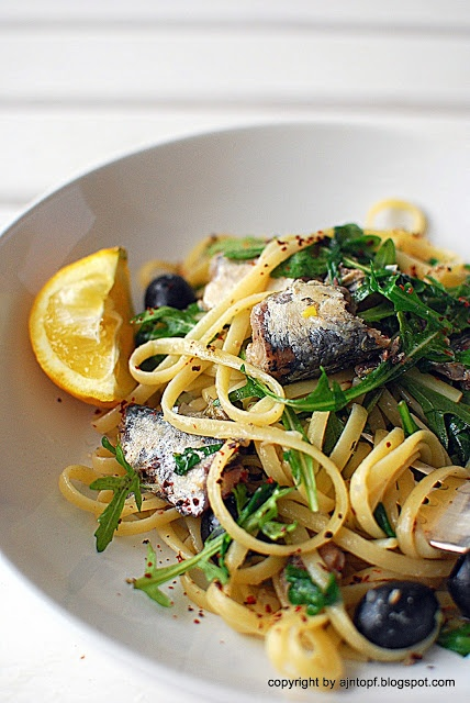 linguine pasta with sardines, olives and capers