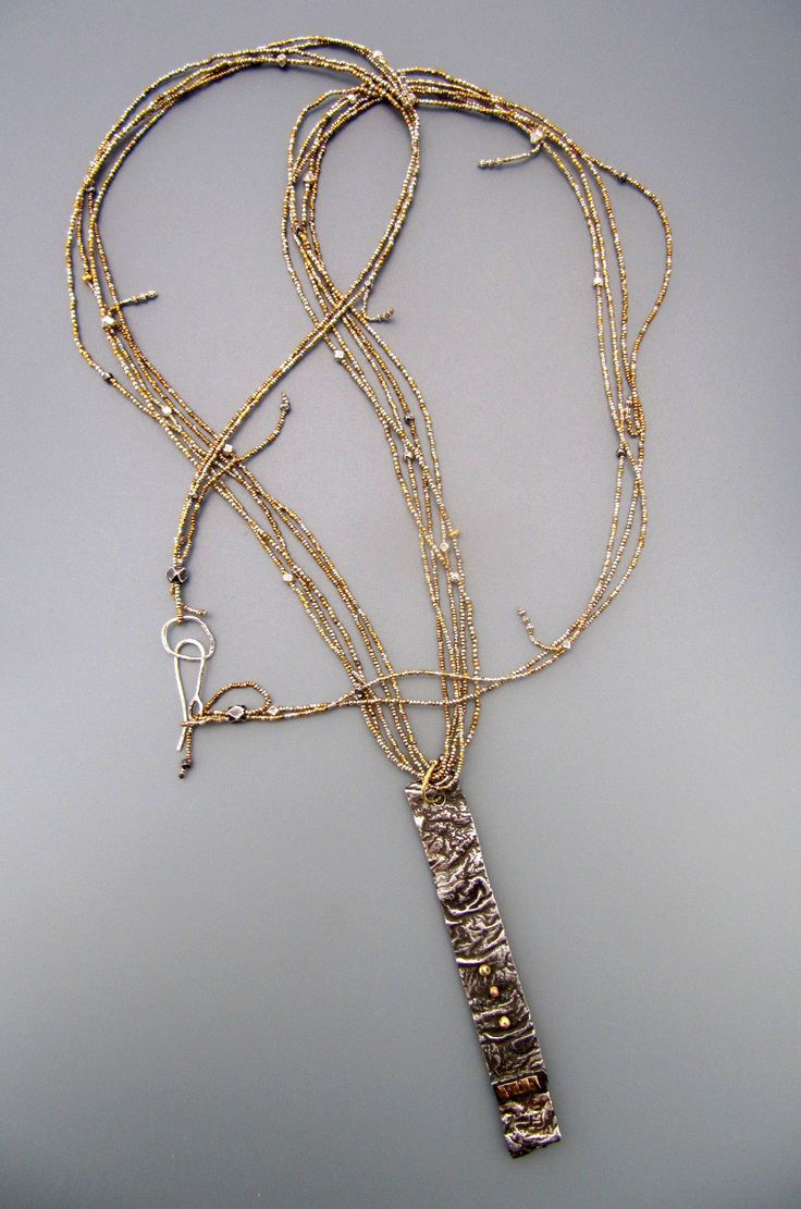 Reticulated Sterling silver pendant with 18 karat gold  LuciaAntonelli.com