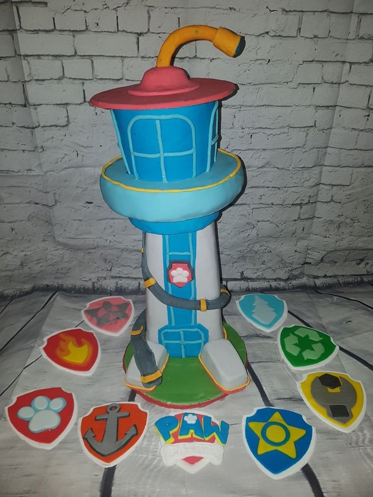 Paw patrol tower cake topper and badges