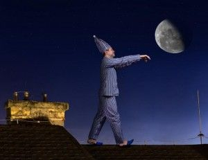 sleepwalking-man-on-a-roof
