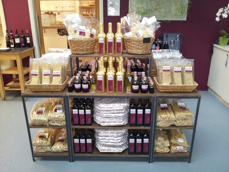 Grouping and repetition is really important in merchandising.  Most of the time you will only have a few seconds to grab your customers attention - Vallebona Deli using retail display units from WBC's Kingsley collection