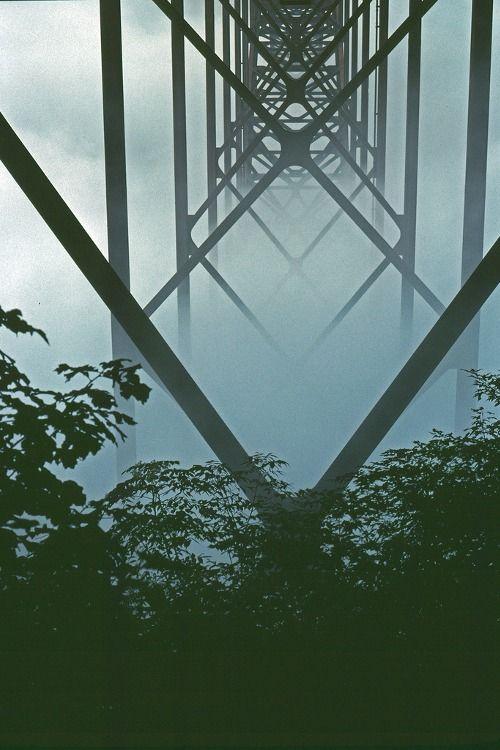 Steel girders on the underside of the New River Gorge Bridge in Fog, West Virginia by Todd Stradford