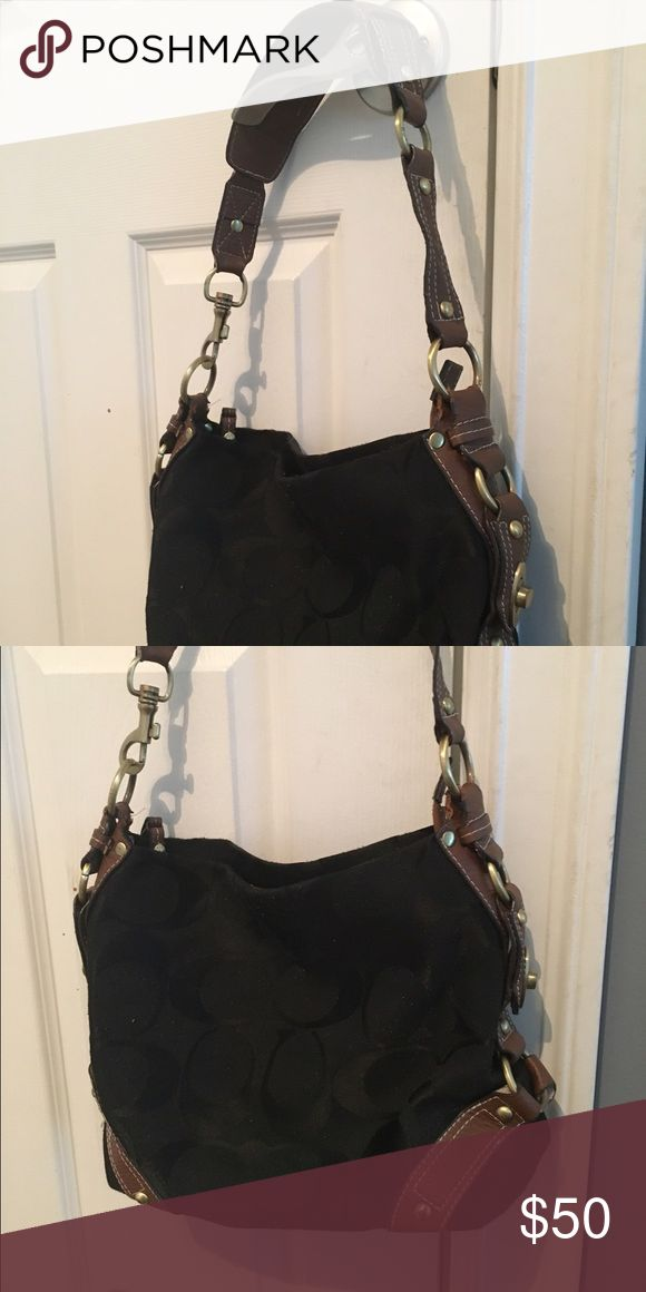 Coach purse Black coach purse with brown handle slightly used. In good condition Coach Bags Shoulder Bags