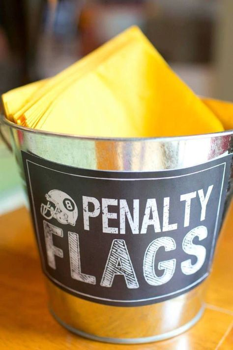 Such a cute idea for football tailgating! Yellow napkin penalty flags.