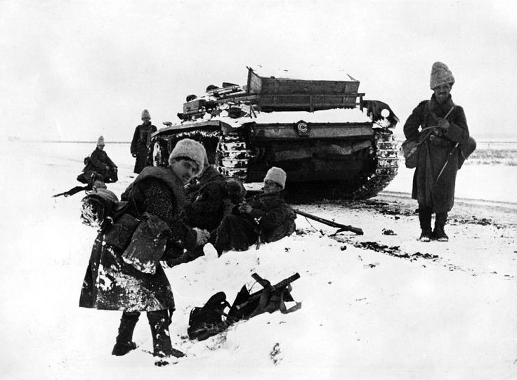 Romanian soldiers of the Romanian Fourth Army (Armata a 4-a Română) rest in the snow en route to Stalingrad (Volgograd) with a German Sturmgeschütz III armored fighting vehicle (StuG III Ausf. F: Sd.Kfz 142/1). From late 1942 to early 1943 the Fourth Army was almost entirely destroyed by the Soviets during the Battle of Stalingrad. After 23 August 1944, King Michael I of Romania led a successful military coup and Romania then sided with the Allies and declared war on former Axis…