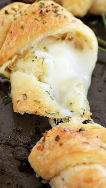 Cheesy Stuffed Garlic Butter Crescent Rolls ~ These soft, golden crescent rolls stuffed with mozzarella make a cheesy, oh-so easy side to any meal.