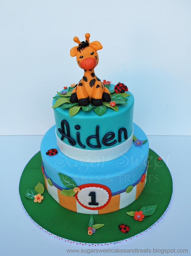 """Giraffe Themed 1st Birthday Cake - cake designed to match the Giraffe themed invitations by """"Birthday Express"""".  9 and 6 inch rounds filled in IMBC and covered MMF.  All decorations are MMF.  Giraffe made out of modeling chocolate.  3 dozen assorted cupcake toppers made to match too.  TFL!"""