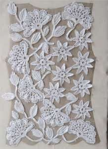This shows how to construct an Irish crochet top. Does not have the graphs for the motifs though.