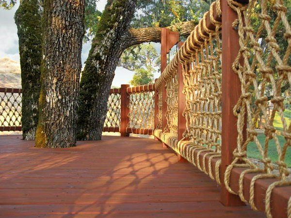 Rope net deck railing. Very creative way to use rope as deck baluster. And the rustic wood and rope deck railing provides great views. Really great idea.